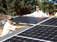 Jeff and Mike installing solar panels.