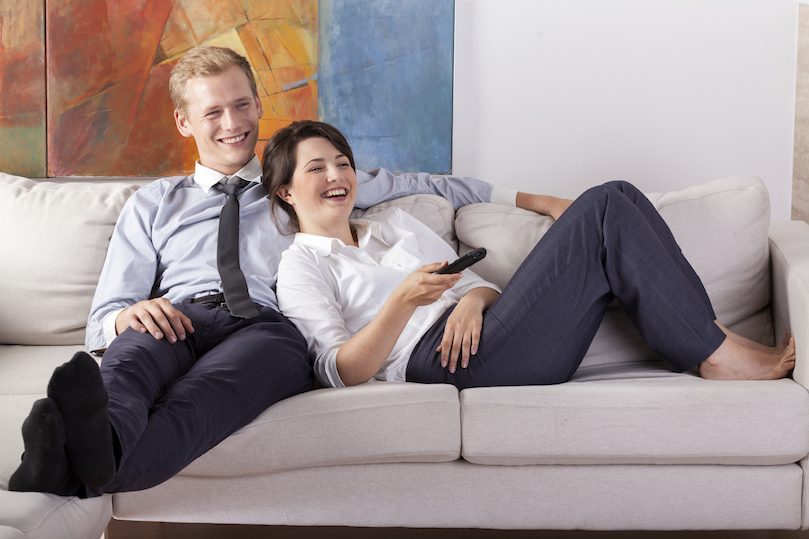 Couple relaxing at home comfortably